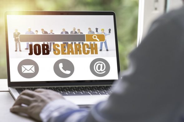 new-graduate-using-laptop-look-online-new-job-search-from-head-hunters-website-recruitment-concept-min
